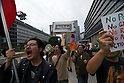 October 15, 2011, Tokyo, Japan - Protesters chant during a Occupy Tokyo protest as it makes it's way through the streets of Shinjuku. Around 500 protesters took part in 3 separate protests in support of the Occupy Tokyo movement. The protesters airing a series of issues including Anti-Nuclear, Anti-Capitalism and Anti-TPP. They chanted '1% no thank you' and ' Nuclear no thank you ' at the rallies. Protesters in the Roppongi's Mikawadai Park numbered about 60 and were out numbered by around 70 Police and 40 members of the media. (Photo by Bruce Meyer-Kenny/AFLO) [3692]