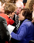 United States Representative Gabrielle Giffords (Democrat of Arizona), left, is greeted by U.S. Representative Nita Lowey (Democrat of New York), right following U.S. President Barack Obama's State of the Union Address to a Joint Session of Congress in the U.S. Capitol in Washington, D.C., Tuesday, January 24, 2012.  U.S. Representative Henry Waxman (Democrat of California)..Credit: Ron Sachs / CNP.(RESTRICTION: NO New York or New Jersey Newspapers or newspapers within a 75 mile radius of New York City)