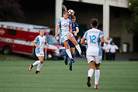 Seattle, WA - Sunday, May 21, 2017: Kristen McNabb and Maddy Evans during a regular season National Women's Soccer League (NWSL) match between the Seattle Reign FC and the Orlando Pride at Memorial Stadium.