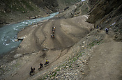 Hindu pilgrims and their guides ride ponies over the glaciers along the Amarnath trekking route in Kashmir, India. Hindu pilgrims brave sub zero temperature and high latitude passes and make their pilgrimage to reach the sacred Amarnath cave, which houses a lingam - a stylized phallus, worshiped by Hindus as a symbol of God Shiva. Photo: Sanjit Das/Panos