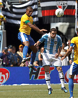 Brazil defender Juan (14) and Argentina forward  Gonzalo Higuain (9) battle for the ball. In an international friendly (Clash of Titans), Argentina defeated Brazil, 4-3, at MetLife Stadium on June 9, 2012.