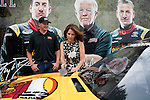 Republican presidential hopeful Michele Bachmann, right, looks at the racecar belonging to driver Michael McDowell of Joe Gibbs Racing, left, after a campaign stop on Friday, August 5, 2011 in Newton, IA.