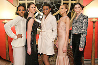 Models pose in an outfit from the Romas by Linda Rowe Thomas, Fall/Winter 2011 collection, during New York Fashion Week.