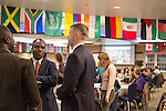 Emmanuel Jean Francois, a faculty member in the Patton College of Education, talks to other faculty during the beginning of The Global Engagement Awards Gala for International Education Week on November 16, 2016.