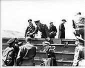 """Vierville Sur Mer, France - June 12, 1944 -- General Dwight D. Eisenhower, United States Army embarks from a """"Duck"""" on the Vierville Sur Mer, France on 12 June, 1944.  Admiral Ernest J. King, United States Navy, and General George C. Marshall, United States Army are in foreground..Credit: U.S. Army photo / CNP"""
