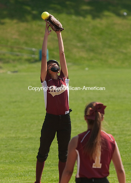 WATERBURY, CT--050815JS04-  Sacred Heart's Vanessa Riddick (2) jumps for a line drive but was unable to control it during their game against Holy Cross Friday at Holy Cross High School in Waterbury. <br /> Jim Shannon Republican-American
