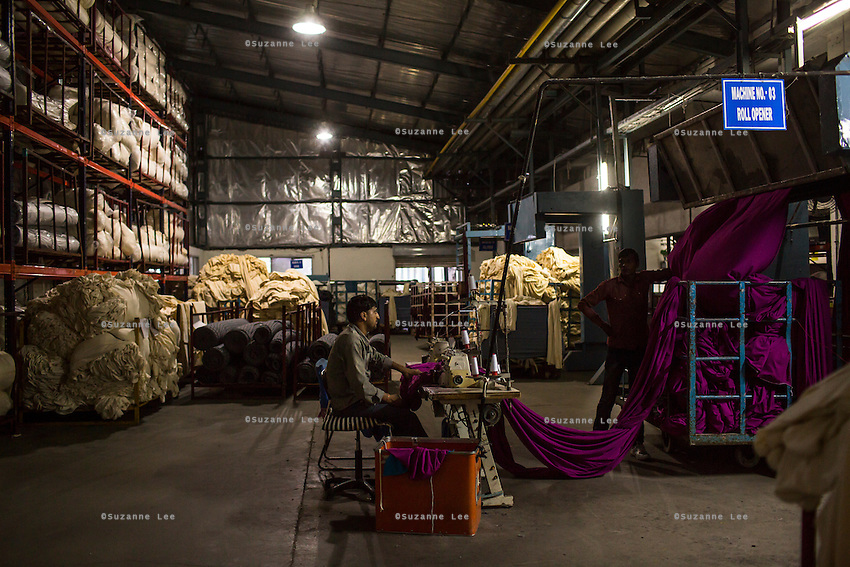 Workers in the Lot Preparation and Roll Opening section of the Pratibha vertically integrated garment unit in Indore, Madhya Pradesh, India on 11 November 2014. Photo by Suzanne Lee for Fairtrade