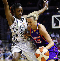 Phoenix player Kelly Mazzante (33) rushes around San Antonio's Morenike Atunrase (24) during the WNBA game between the San Antonio Silver Stars and the Phoenix Mercury, May 20, 2008, at the AT&T Center, San Antonio, Texas. San Antonio won 81 - 76. (Darren Abate/PressPhotoIntl.com)