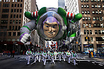 People take part of the annual Thanksgiving day parade with a Buzz's balloon in New York, November 22, 2012. . Photo by Eduardo Munoz Alvarez / VIEWpress