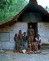 "Shark caller Robert teaches the boys of Tembin village the traditions of his people in the ""hausboy""... a hut in the village set aside for all the boys to live in once they attain a certain age..Kontu, New Ireland Province, Papua New Guinea;"