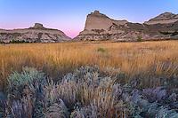 Scotts Bluff National Monument, Nebraska:<br /> Scotts Bluff rises above prairie grasses at dawn.