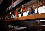 A woman weaves at a loom, part of a livelihood project sponsored by the ACT Alliance in the Dadaab refugee camp in northeastern Kenya. Tens of thousands of refugees have fled drought-stricken Somalia in recent weeks, swelling what was already the world's largest refugee settlement. The Lutheran World Federation--a member of the ACT Alliance--manages the camp, and is working with United Nations agencies and other NGOs to receive, house and care for the new refugees.