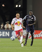 New York Red Bulls midfielder Joel Lindpere (20) passes the ball as New England Revolution midfielder Shalrie Joseph (21) closes. The New England Revolution defeated the New York Red Bulls, 3-2, at Gillette Stadium on May 29, 2010.