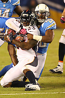 10/15/12 San Diego, CA: Denver Broncos running back Willis McGahee #23 and San Diego Chargers cornerback Antoine Cason #20 during an NFL game played between the San Diego Chargers and the Denver Broncos at Qualcomm Stadium. The Broncos defeated the Chargers 35-24.