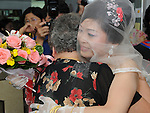 Taiwanese Wedding -- A final farewell between mother and daughter before the daughter leaves the parental home and officially becomes a member of the groom's family.