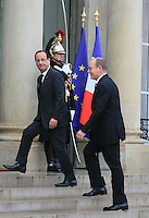 "Prince Albert II of Monaco and French President Francois Hollande at the ""Palais de l'Elysée"""