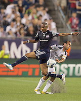 New England Revolution defender Darrius Barnes (25) attempts to block Los Angeles Galaxy midfielder Landon Donovan (10) pass. In a Major League Soccer (MLS) match, the Los Angeles Galaxy defeated the New England Revolution, 1-0, at Gillette Stadium on May 28, 2011.