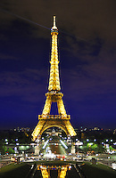 Eiffel (Eifel) tower by night illuminated with dramatic sky