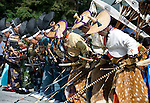 Horseback archers bow during the annual Reitaisai Grand Festival at Tsurugaoka Hachimangu Shrine in Kamakura, Japan on  14 Sept. 2012.  Sept 14 marks the first day of the 3-day Reitaisai festival, which starts early in the morning when shrine priests and officials perform a purification ritual in the ocean during a rite known as hamaorisai and limaxes with a display of yabusame horseback archery. Photographer: Robert Gilhooly