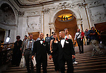 Newlyweds Frank Capley, 33, and Joe Alfano, 37, walk down the main staircase after their wedding ceremony, at City Hall, in San Francisco, CA, on Tuesday, June 17, 2008. The couple have been together for 8 years. They first married in 2004.