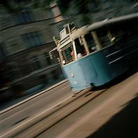 Tram travelling down the street in Stockholm, Sweden