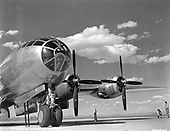 The B-29 bomber, produced by the Boeing Aircraft Company during the war, was the first long-range heavy bomber employed by the United States. It was primarily used in the war's Pacific Theater, and became notorious as the plane used to drop the world's first atomic bombs on the cities of Hiroshima and Nagasaki, Japan, August 6 and 9, 1945.  The Boeing B-29 was designed in 1940 as an eventual replacement for the B-17 and B-24. The first one built made its maiden flight on Sept. 21, 1942. Developing the Boeing B-29 was a program which rivaled the Manhattan Project in size and expense. Technically a generation ahead of all other heavy bomber types in World War II, the Superfortress was pressurized for high altitudes and featured remotely-controlled gun turrets. Most important, its four supercharged Wright R-3350-23 engines gave it the range to carry large bomb loads across the vast reaches of the Pacific Ocean..Credit: U.S. Air Force via CNP