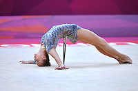 August 10, 2012; London, Great Britain;  ANNA RIZATDINOVA of Ukraine holds beginning pose with clubs during day 2 of rhythmic gymnastics qualifying at London 2012 Olympics.
