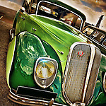 USA classic car in green with chrome grill from the 1950's