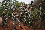 Brig. B.K.Ponwar (centre) poses for a portrait with his commandoes at the Counter Terrorism and Jungle Warfare College in Kanker, Chhattisgarh, India. Photograph by Sanjit Das/Panos for The Times.