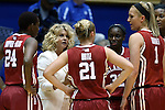 17 December 2014: Oklahoma head coach Sherri Coale talks to her players Sharane Campbell-Olds (24), Gabbi Ortiz (21), LaNesia Williams (32) and Nicole Kornet (1) during a timeout. The Duke University Blue Devils hosted the University of Oklahoma Sooners at Cameron Indoor Stadium in Durham, North Carolina in a 2014-15 NCAA Division I Women's Basketball game. Duke won the game 92-72.