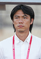 Ghana's head coach Myung Bo Hong stands on the field before the match against South Korea during the FIFA Under 20 World Cup Quarter-final match between Ghana and South Korea at the Mubarak Stadium  in Suez, Egypt, on October 09, 2009.