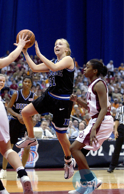 29 MAR 2002:  Duke University guard Krista Gingrich (21) drives to the hoop against the University of Oklahoma during their Division 1 Women's Basketball Semifinal game held at the Alamodome in San Antonio, TX.  Oklahoma defeated Duke 86-71to advance to the national title game.  Jamie Schwaberow/NCAA Photos