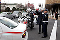 March 11, 2011, Tokyo, Japan - Police direct traffic flows in Tokyo's Ikebukuro area following a severe earthquake that struck Japan's northeastern prefectures on Friday, March 11, 2011. Hundreds of people are feared dead after the country's biggest earthquake with a magnitude of 8.9 since records began struck the northeastern coasts, unleashing a 10-metre tsunami that swept away buildings, ships and vehicles. (Photo by AFLO) [3609] -mis-