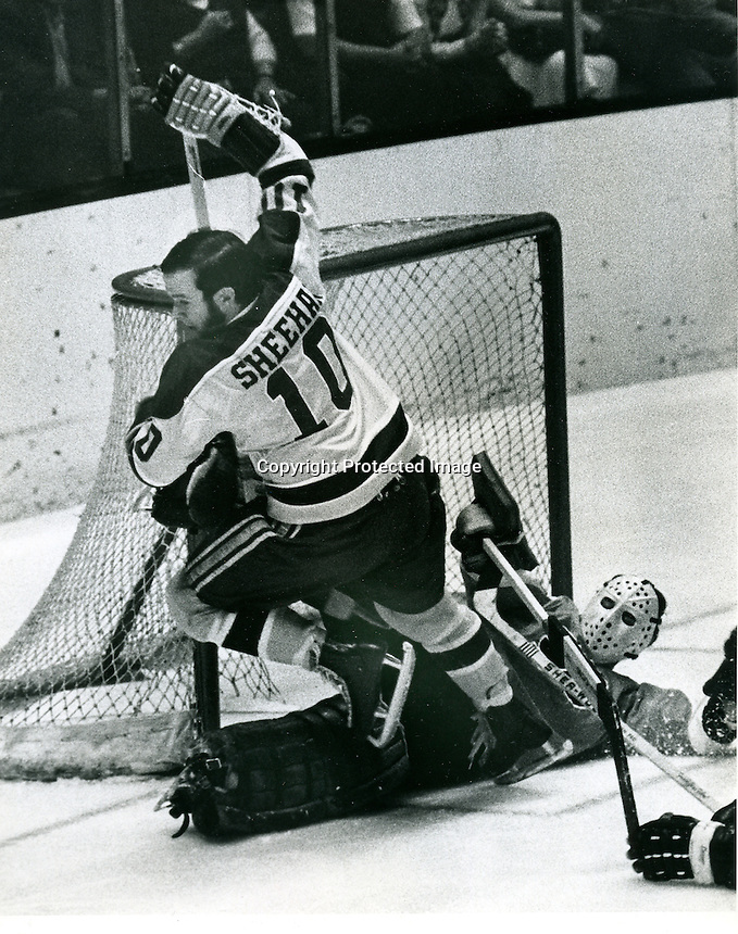 Seals Bobby Sheehan on top of Flyers goalie Bruce Gamble.<br />
