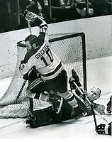 Seals Bobby Sheehan on top of Flyers goalie Bruce Gamble.<br /> 1971 photo by Ron Riesterer