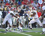 Ole Miss' Jeff Scott (3) is tackled by Alabama defensive back Mark Barron (4) at Vaught-Hemingway Stadium in Oxford, Miss. on Saturday, October 14, 2011. Alabama won 52-7.