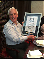 BNPS.co.uk (01202 558833)<br /> Pic: AdrianFisherDesignLtd/BNPS<br /> <br /> Adrian Fisher with his Guinnes world record.<br /> <br /> A-mazing record...<br /> <br /> A British company has set two Guinness world records by creating the largest hedge maze on the planet.<br /> <br /> The Maze of the Butterfly Lovers now holds the records for the largest hedge maze by area at 8.29 acres - equivalent to four football pitches - and the maze with the greatest length of paths at 5.2 miles.<br /> <br /> The impressive attraction in Ningbo in China was created by Adrian Fisher Design Ltd of Durweston, Dorset, and cost &pound;1m.