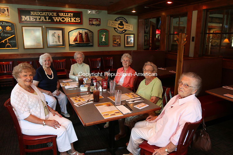 TORRINGTON, CT - 3 August, 2011 - 080311MO01 - Torrington Manufacturing veterans, from left, Peg Falk, Ruth Roelofs, Minnie Florio, Terry Ethier, Myrtle Daley and Myrtle Dobos gathered Wednesday at the 99 Restaurant, across the river from the company headquarters where they worked in the 1940s and 1950s. They shared stories about their lives then and since, comparing notes about children, grandchildren and great-grandchildren. Jim Moore Republican-American.