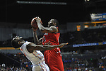 Ole Miss' Murphy Holloway (31) is called for charging against Florida's Patric Young (4) in the SEC championship game at Bridgestone Arena in Nashville, Tenn. on Sunday, March 17, 2013.