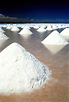 Piles of salt are lined up in rows on the salt flats at Uyuni, Bolivia.