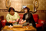 (L-R) Shala Omar and Samra Amerie peel walnuts for a beverage called, haft miwa, which is made of seven kinds of fruit, in the office of the Diamond Palace nightclub, in Fremont, Ca., on Tuesday, March 17, 2009.