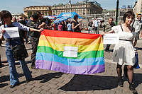 Moscow, Russia, 28/05/2011..Gay rights activists unfurl a rainbow flag at an attempted gay pride parade in central Moscow. Several dozen people were arrested during clashes as Russian nationalists attacked gay rights activists during their sixth attempt to hold a gay pride parade in the Russian capital.