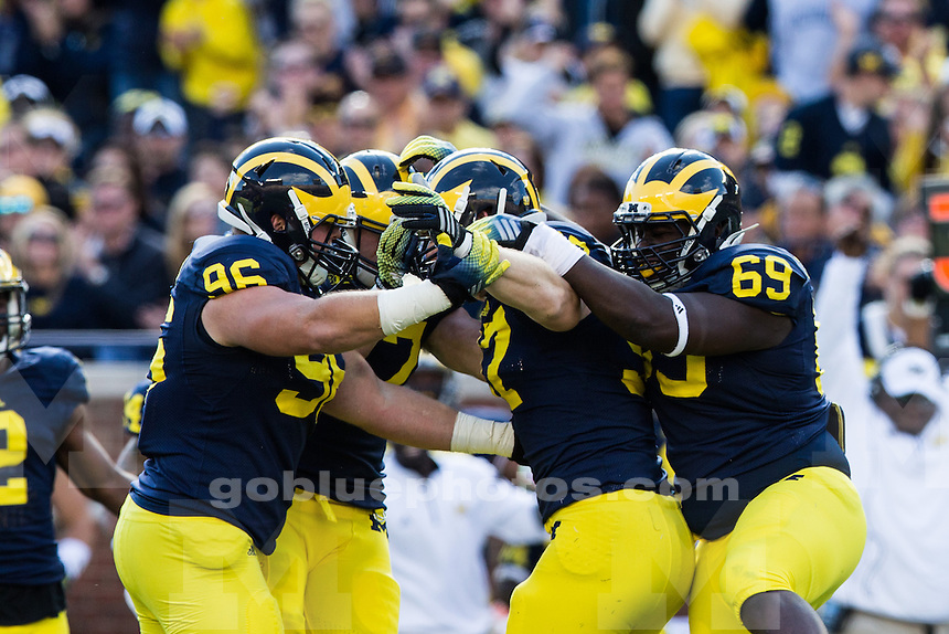 The University of Michigan football team defeats Miami University 34-10 at Michigan Stadium in Ann Arbor, Mich., on Sept. 13, 2014.