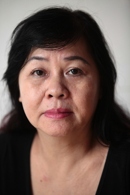 """Phung Huynh Thi, 63, worked from 1967 to 1972 as a PX cashier at the U.S. Special Forces camp in Nha Trang, Vietnam. After the war ended in 1975, she discovered that her father -- whom she thought was dead  -- had been serving with the Viet Cong. """"I never knew my father was VC,"""" she says. """"My mother never told me."""" Wanting to join her sister, who had married a Special Forces officer and moved to Washington state, she tried to flee the country on three separate occasions, but she was caught each time, imprisoned and interrogated. """"Everyday, they would come and ask me the same questions,"""" she recalls. """"But I never told them I worked for the Americans.""""  Married since 2009 to a New Zealand citizen, she says she no longer dreams of leaving. """"Now I think to stay in Vietnam is better for me,"""" she says. """"Now I'm too old to go. Now I have a good man.""""  July 18, 2011."""