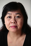 Phung Huynh Thi, 63, worked from 1967 to 1972 as a PX cashier at the U.S. Special Forces camp in Nha Trang, Vietnam. After the war ended in 1975, she discovered that her father -- whom she thought was dead  -- had been serving with the Viet Cong. &quot;I never knew my father was VC,&quot; she says. &quot;My mother never told me.&quot; Wanting to join her sister, who had married a Special Forces officer and moved to Washington state, she tried to flee the country on three separate occasions, but she was caught each time, imprisoned and interrogated. &quot;Everyday, they would come and ask me the same questions,&quot; she recalls. &quot;But I never told them I worked for the Americans.&quot;  Married since 2009 to a New Zealand citizen, she says she no longer dreams of leaving. &quot;Now I think to stay in Vietnam is better for me,&quot; she says. &quot;Now I'm too old to go. Now I have a good man.&quot;  July 18, 2011.