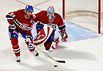 6 February 2007: Montreal Canadiens goaltender David Aebischer of Switzerland watches defenseman Sheldon Souray (44) clear the puck against the Carolina Hurricanes at the Bell Centre in Montreal, Canada. The Hurricanes defeated the Canadiens 2-1.....Mandatory Photo Credit: Ed Wolfstein *** Editorial Sales through Icon Sports Media *** www.iconsportsmedia.com