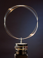 STANDING WAVE ON CIRCULAR HOOP<br /> (9 of 12 - Variations Available)<br /> Analog - de Broglie Wavelengths &amp; Bohr Orbits<br /> A circular hoop of wire is vibrated at a variable frequency. At a frequency of 89 Hz the standing wave is visible on the wire- analagous  to the de Broglie formula for the electron orbital and showing the wave-particle duality of matter.