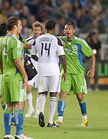 CARSON, CA – NOVEMBER 7:  LA Galaxy forward Edson Buddle (14) and Seattle Sounders defender Tyrone Marshall (14) during a soccer match at the Home Depot Center, November 7, 2010 in Carson, California. Final score LA Galaxy 2, Seattle Sounders 1.