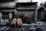 SYRIA, ALEPPO. Rebels fighters stand in a frontline position in the old souq of Aleppo on September 24, 2012. ALESSIO ROMENZI