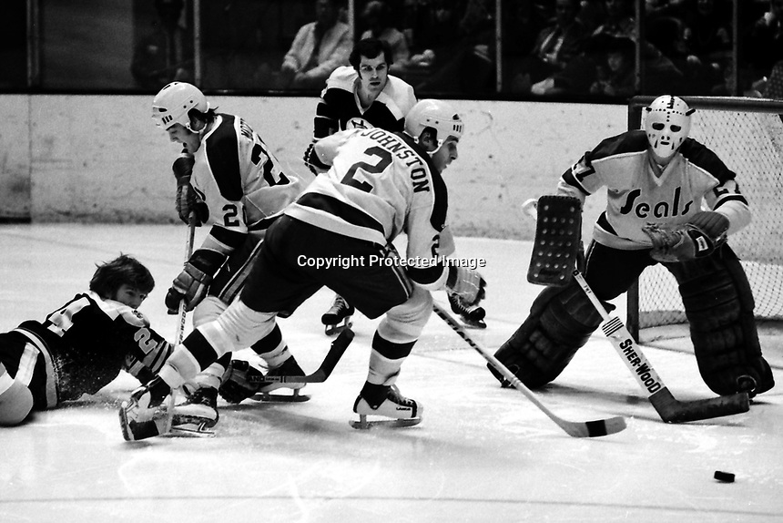 Seals vs Boston Bruins 1975 NHL action, Seals Bob Murdoch and Marshall Johnston and goalie Gilles Meloche. (1975 photo/Ron Riesterer)